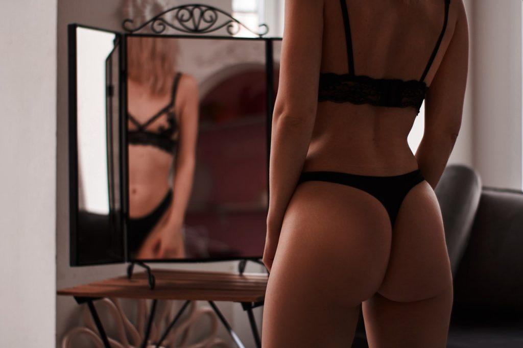 Masturbate in front of a mirror